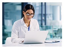 doctor looking at a laptop
